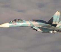 Russian Fighter Su-27 intercepts P-3 Orion over Baltic Sea [Video]